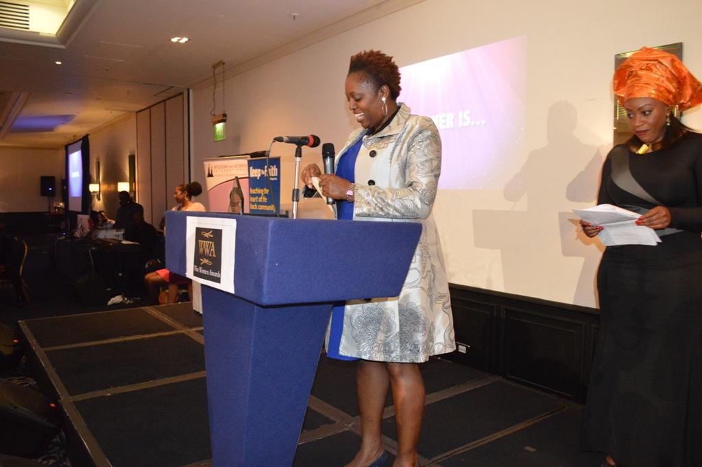 Abbih Oloyode of Womenz world reading an award