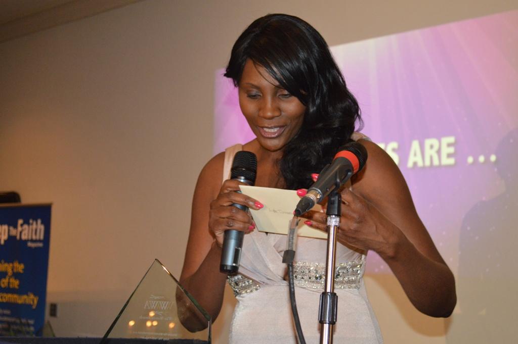 Caroline Marsh of the Secret Millionaire Fame opening an award