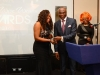 Pastor Clem Esomowei presents Exceptional Woman Award to Nancy Laggah