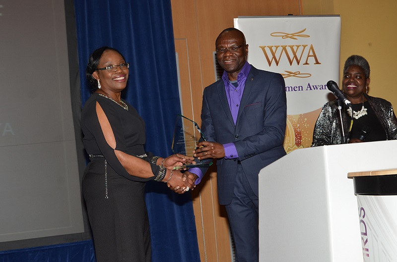 Ronke Olukoya collects her TCI Exceptional Woman Award from Pastor Clem Esomowei